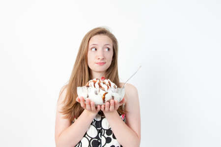 weighs: Part of a series of facial expressions as the girl weighs out her choice. Stock Photo