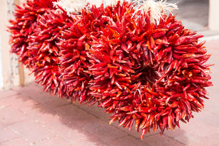 chiles secos: Iconic ristras and wreaths of dried red chiles hang everywhere in Santa Fe New Mexico