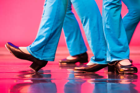 colourful stage filled with tap dancing feet Stock fotó