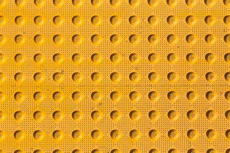 tread pattern: textured yellow industrial tread pattern from parking lot access cover