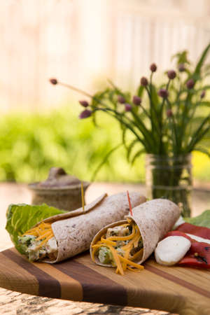 al fresco: fresh lunch of chicken salad wraps on the patio in summer