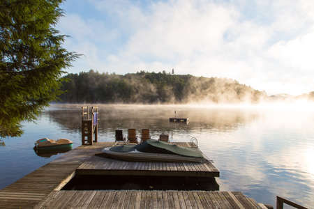 peddle: Early morning sun rises over the dock on the narrows on Lake of Bays in Muskoka