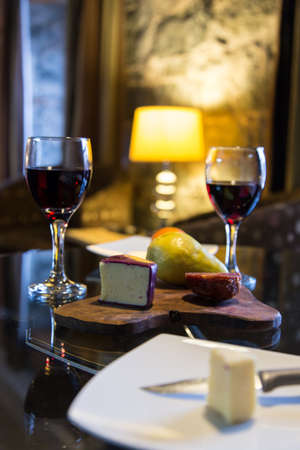 warm and cozy on a winter day with an appetizer of wine and cheese for two Stock Photo