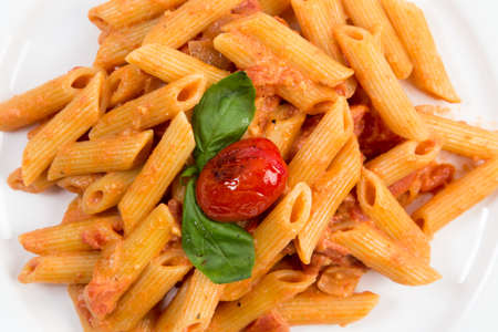 plating: Close up on Penne Ala Vodka served on a white dinner plate  Stock Photo