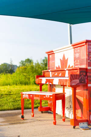 London, Ontario, Canada-June 3 2017: The Hyde Park outdoor Piano painted by the students of Oakridge secondary school in the theme of our Canadian 150 year celebration.  The piano is presented by businesses in the area and left outside all season for the Editorial