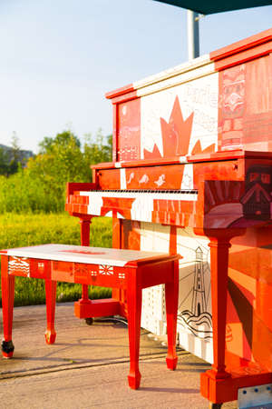 London, Ontario, Canada-June 3 2017: The Hyde Park outdoor Piano painted by the students of Oakridge secondary school in the theme of our Canadian 150 year celebration.