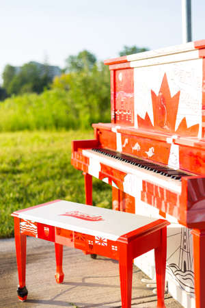 London, Ontario, Canada-June 3 2017: The Hyde Park outdoor Piano painted by the students of Oakridge secondary school in the theme of our Canadian 150 year celebration.  The piano is left outside for the summer. Editorial