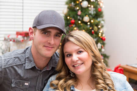 portrait of a young millennial couple at Christmas Stock Photo