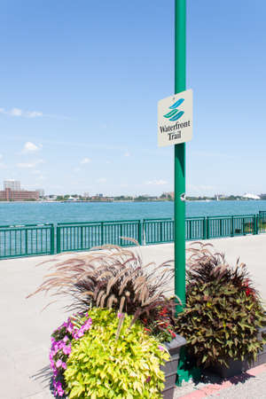 the scenic waterfront trail follows the waters edge along the Detroit river in Windsor Ontario Canada