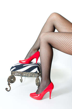 beautiful womans legs with red stiletto shoes Standard-Bild