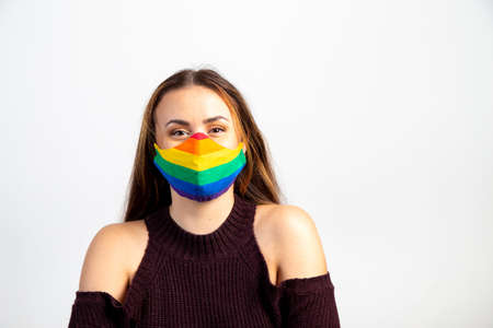 Young woman wearing gay pride rainbow mask Stock Photo