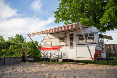 A vintage trailer parked on a rural campsite.. No People. Standard-Bild