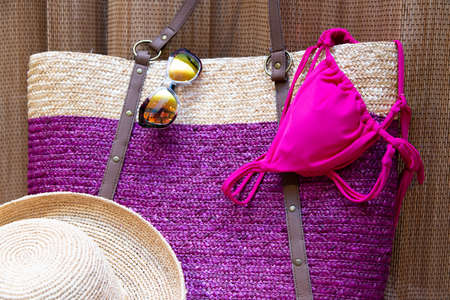 beach accessories on a brown tiki style background