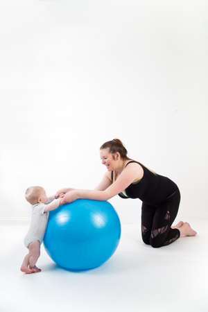 mother with baby having fun with gymnastic ball Standard-Bild