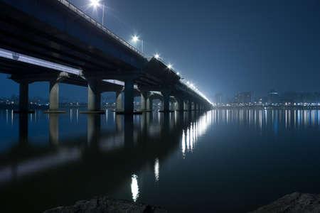 dramatic night view of Seoul city skyline and a bridge photo