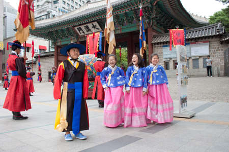 SEOUL, KOREA - JUNE 07 Children wearing Korean national costumes, are being taken photo during a changing of the guards  Changing of guards takes place at the Gyeongbokgung Palace on June 07, 2011 in Seoul, South Korea  This ceremony comes from the Choson