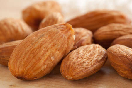 Almonds on wooden background  Stock Photo - 12843519