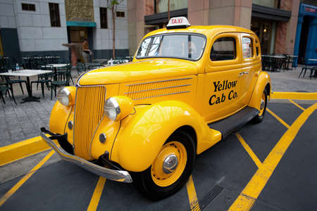 Singapore - April 19: Universal Studios Singapore. Retro Yellow Cab on April 19, 2012, in Singapore. The Yellow Cab Company was founded in Chicago in 1914 by John D. Hertz and started business in 1915.