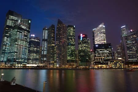 watershed: SINGAPORE - APRIL 23: A Part Singapore Downtown Core at night on April 23, 2012 in Singapore.It surrounds the mouth of the Singapore River and southeastern portion of its watershed, and is part of the Central Area, Singapores central business district.