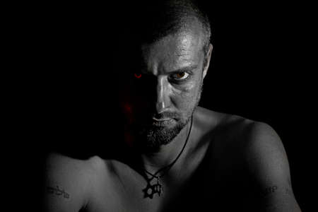 Tough man with star of David on his neck photo