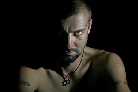 light eyes: Tough man with star of David on his neck