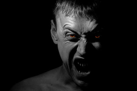 evil eyes: Screaming man possessed by demon Stock Photo
