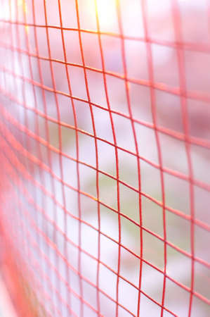 red metallic: Red metallic cage background with blurred bokeh backdrop.