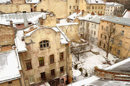 Old buildings and snow-covered roofs. Winter view of the downtown in Lviv, Ukraine. Stock Photo