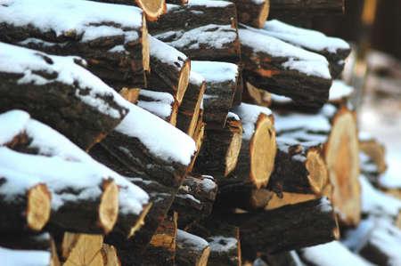 snowbound: Snowbound woodpile under rural shed. Winter background. Stock Photo