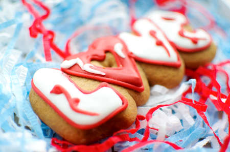 Letter cookies for Valentines day or for a wedding day on the blue and white paper filler background. Stock Photo