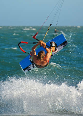 kiteboarding: kiteboarding, kitesurfing, kiteboarder performing unhooked tricks