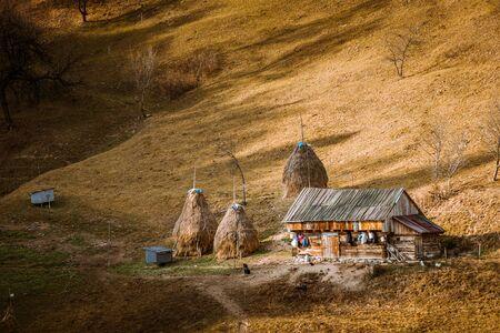 Romanian village landscape from Transylvania Romania, Autumn, November 2019 with an isolated shepherds barn house