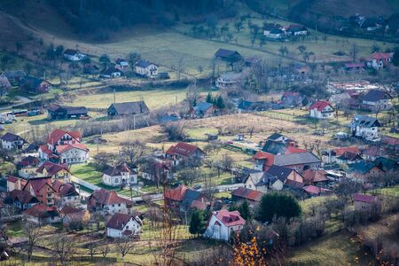 Romanian village aerial landscape from Transylvania Romania, Autumn, November 2019 with houses from Bran Moeciu drone Stock Photo