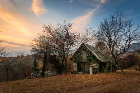 stunning scenic landscape from Transylvania, Romania autumn over a ruined house and barn in Bran Viscri Brasov Stock Photo