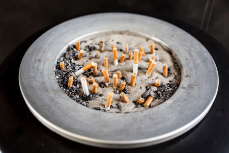 breathlessness: ashtray with cigarette butts