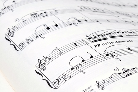 Music notes on a book Stock Photo