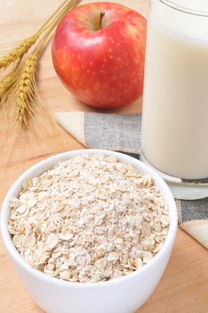 Healthy breakfast with avena, milk, and apple. Stock Photo
