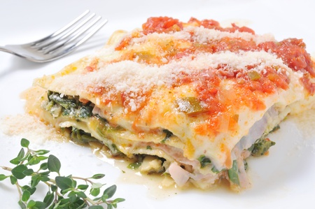 Portion of lasagna served on a plate Stock Photo
