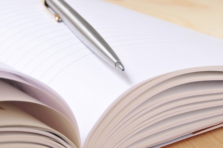 Open notebook with pen. Stock Photo