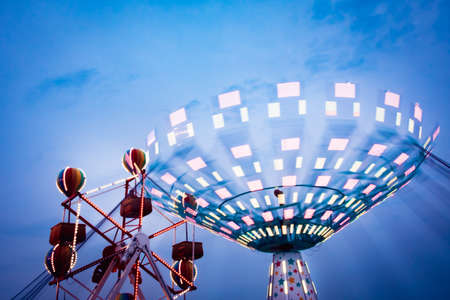 The glow of the 4h camp fair blurs in the summer sky. Stock Photo