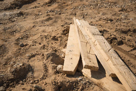 lays: Few wooden boards lays on a ground
