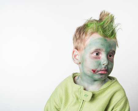 Sad little boy dressed as a zombie on halloween Stock Photo
