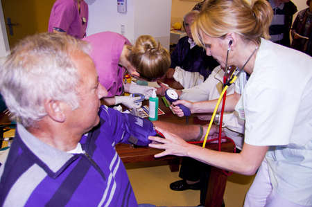 Eisenh?nstadt, Germany - 13 October 2012 : Open doors at the St?isches Krankenhaus. Nurses checking blood pressure and blood sugar.  Stock Photo - 15927905