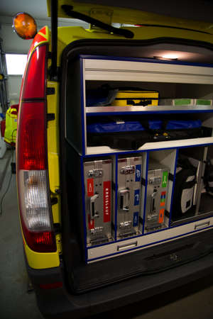 Paramedic emergency vehicle  from the back with open door and equipment inside. EMS  photo