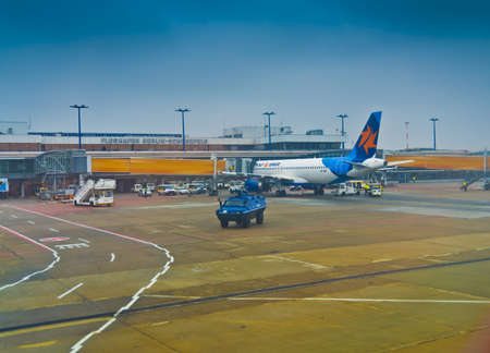 Berlin, Germany - February 14, 2013: Israeli airplane of Israir Airlines protected by German police tank and armed cops on Schonefeld airport in Berlin by a presumed terrorist attack.German Police is taking extreme security measures.
