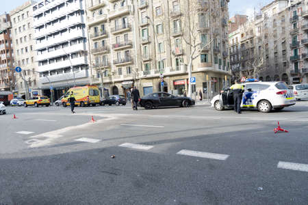 Barcelona, Spain - February 14, 2013 : Police, Policia Local, Guardia Urbana are clearing the aria for fluidity of the traffic in the downtown Barcelona on Parallel street one of the most trafficked, difficult and noisy street. Emergency Service and SEM -