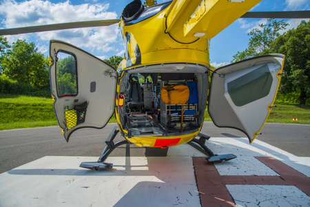Paramedics helicopter prepared to uploading patient with back dors open Foto de archivo