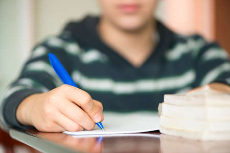 Young boy learning and writing in a notebook photo