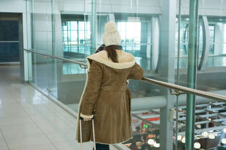 Young woman in airport traveling to a tourist attraction