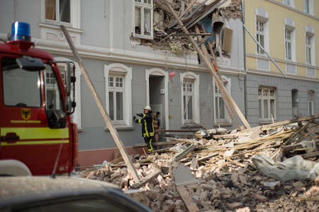 Dortmund, Germany - March 31, 2017: Fire fighters have managed to found and rescued the first man after a a old house build in 1921 who collapsed  under his own weight, with people living inside